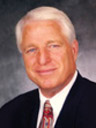 Dale E. Scott, SCDP